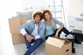 Couple getting in their new apartment to live together
