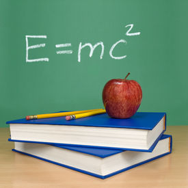 stock photo of einstein  - Einsteins formula of theory of relativity on a chalkboard - JPG