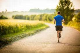 stock photo of jogger  - Male athlete - JPG