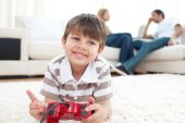 Smiling Little Boy Playing Video Games poster