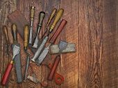 Vintage Chisels And Stones Collage Over Old Wooden Bench