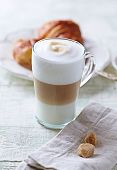 Glass of Latte Macchiato and Croissant
