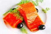 smoked fresh salmon piece with olives and fennel