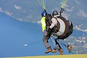 stock photo of annecy  - tandem paraglider launching flight above Lake Annecy