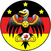 Black eagle holding a soccer ball and posing in a German coat of arms