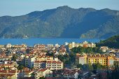 MARMARIS, TURKEY - APRIL 19, 2014: Cityscape and the bay of Marmaris. City population increases 10 times during the tourism season, and its nightlife rivals anything on the Turkish coast