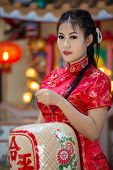 Chinese Girl In Traditional Chinese Cheongsam Blessing