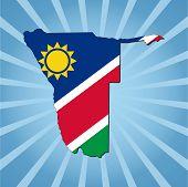 Namibia map flag on blue sunburst illustration