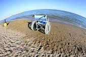 Wheelchairs  With Steel Wheels On The Beach
