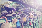Padlocks On A Bridge, Vintage Style Photo.
