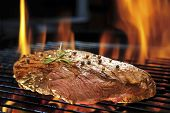 image of flame-grilled  - Grilled meat on the flaming grill  - JPG