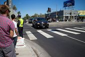LOS ANGELES - July 23, 2014: President Barack Obama's motorcade crossing corner of 3rd Street and La