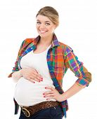 Beautiful pregnant white woman wearing shirt with hands on belly isolated on a white background