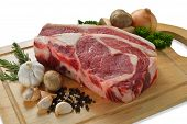 picture of rib eye steak  - Raw meat ready to be cooked on white background  - JPG
