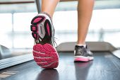 foto of treadmill  - Womans feet running on the treadmill at the gym - JPG