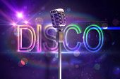 Retro microphone on stand against digitally generated colourful disco text