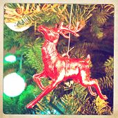 Instagram filtered style image of a reindeer christmas ornament