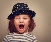 Angry Shouting Kid Girl With Open Mouth. Closeup Vintage Portrait