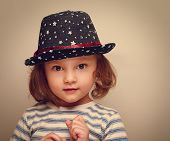 Wonder Kid Girl In Trendy Hat Looking. Closeup Vintage Portrait