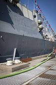 STATEN ISLAND, NY - MAY 25, 2014: The dock mooring bollards and gray hull of the guided-missile dest