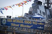 STATEN ISLAND, NY - MAY 25, 2014: The ships banner hangs from the metal gangplank of the guided-missile destroyer USS McFaul (DDG 074) moored at Sullivans Piers during Fleet Week NY.