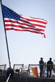 STATEN ISLAND, NY - MAY 25, 2014: The American flag flies from the stern of the guided-missile destr