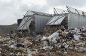 stock photo of landfill  - Trucks dumping waste at landfill site - JPG