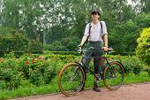 MOSCOW - JUNE 7: Member of the Historic Bike Ride in the park Sokolniki on June 7, 2014 in Moscow. A