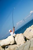 Piran, Slovenia - 21 September 2016: Elderly fisherman by the seashore.