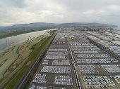 Koper, Slovenia - 2 May 2014: Aerial view on parked cars in Koper port in Slovenia.