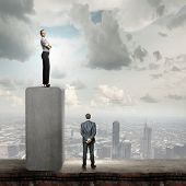 Conceptual image of businessman and businesswoman standing on top of bar