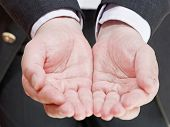 Businessman Holding Empty Handful From Two Palms