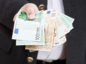 Fanned Euro Banknotes In Male Hands