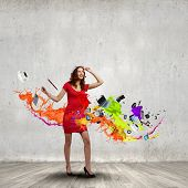 Woman in red dress among colorful splashes