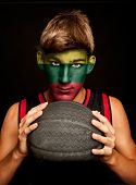 portrait of basketball player with lithuanian flag painted on his face