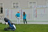 TSELEEVO, MOSCOW REGION, RUSSIA - JULY 24, 2014: Golfer under the scoreboard of M2M Russian Open in