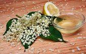 stock photo of elderberry  - Health drink lemonade from elderberry flowers on a wooden table - JPG