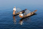 Myanmar travel attraction landmark - Traditional Burmese fishermen with fishing net at Inle lake in