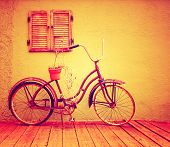 a vintage bike with retro shutters toned with a warm instagram filter