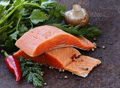 fresh salmon (red fish) fillet with herbs, spices and vegetables - healthy food