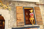 Pinocchio In The Window  Building Store Of Wooden Toys In San Marino. The Republic Of San Marino