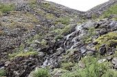 Waterfall in the mountains, Arctic tundra,Russia.