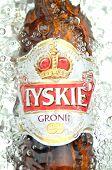 Tyskie pale lager beer in splashed water