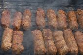 Barbecuing Minced Meat On Charcoal Fire Closeup Image.