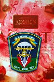 Illustative editorial.Ukrainian military paratroopers chevron.With logo Roshen Inc. Trademark Roshen is property of ukrainian president Poroshenko.At December 25,2014 in Kiev, Ukraine