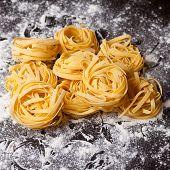 Raw Pasta Tagliatelle On Table