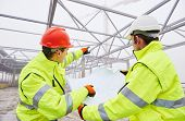 stock photo of engineering construction  - male engineers construction foreman managers outdoors indoors at building site with blueprints - JPG