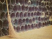 stock photo of fishnet  - close up of a wicked broom by a group of fishnets in vintage tone - JPG