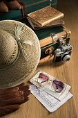 stock photo of old suitcase  - Vintage traveler suitcase with sunglasses straw hat old camera and maps.