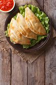 Empanadas And Sauce Closeup. Vertical Top View, Rustic